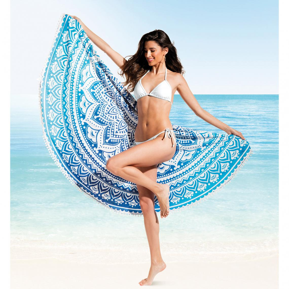 DESCRIPTION: Nouvelle tendance sur la plage cet été, cette grande serviette ronde originale est idéale pour paresser sous le soleil ou même pique-niquer sur le sable... véritable accessoire de mode, il devient en un clin