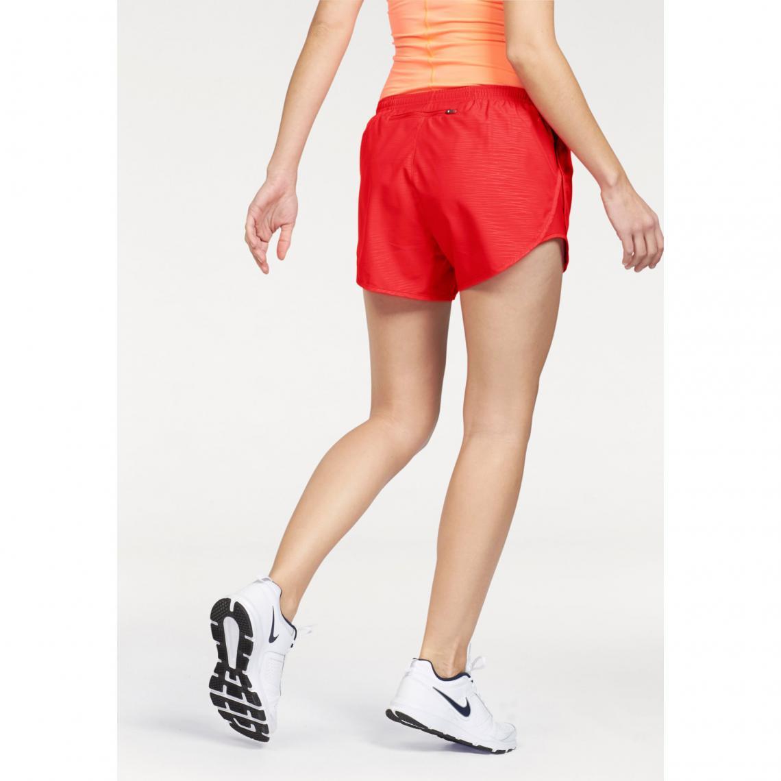 check out 86061 aeef5 Pantalon / Short de sport Nike Cliquez l'image pour l'agrandir. Short court  femme Nike Modern Embossed Tempo de Nike ...
