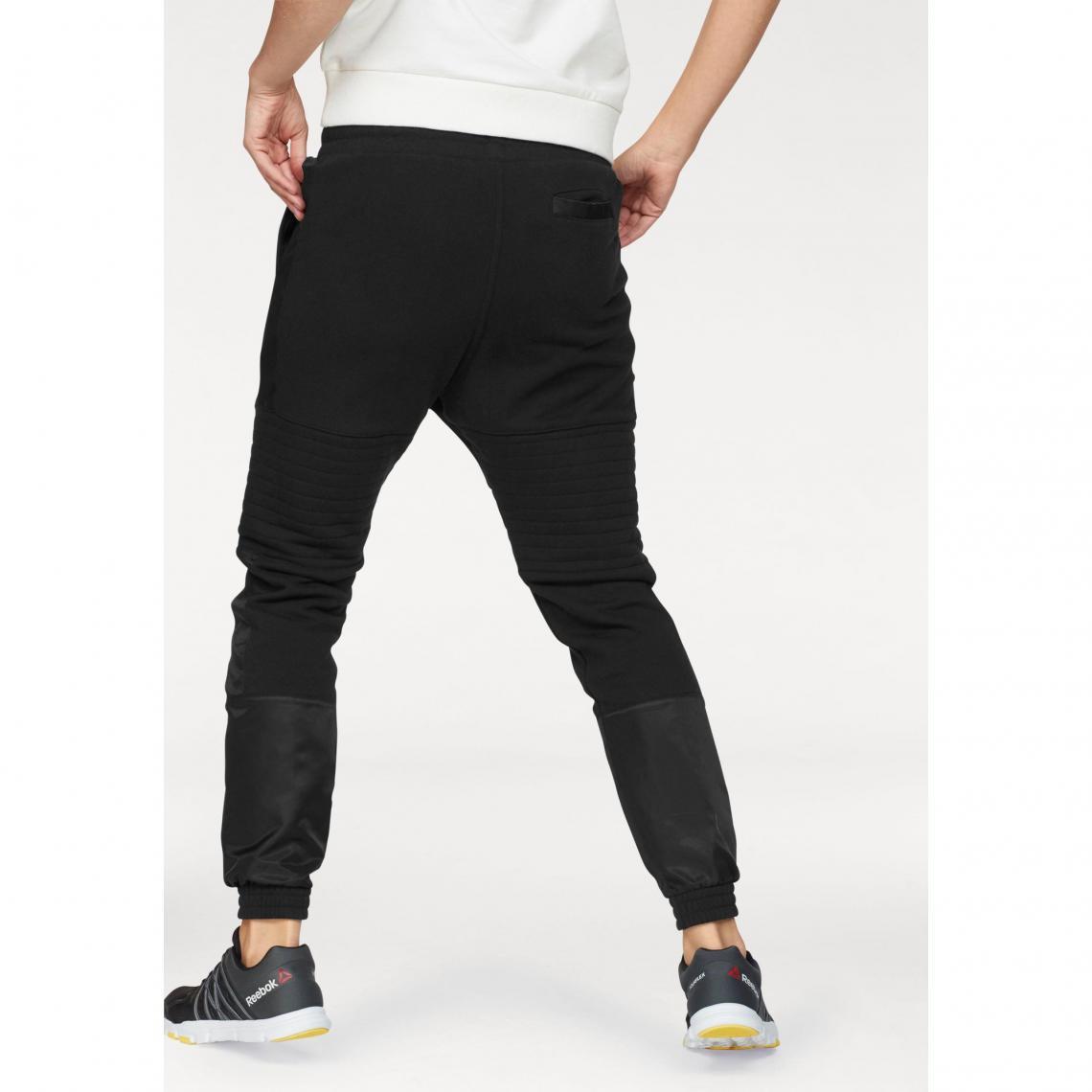 Pantalons de sport femme Reebok Cliquez l image pour l agrandir. Pantalon  sport femme Moto Jogger Reebok - Noir Reebok 6d0c9197d2b